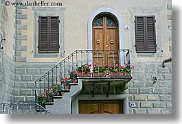 archways, balconies, doors, europe, flowers, geraniums, horizontal, italy, montalcino, towns, tuscany, photograph