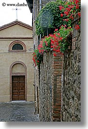 archways, cobblestones, doors, europe, flowers, italy, montalcino, stones, towns, tuscany, vertical, walls, photograph
