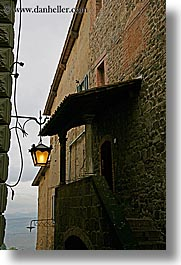 europe, italy, lamp posts, montalcino, towns, tuscany, vertical, windows, photograph