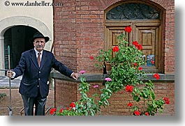 bricks, europe, flowers, gardeners, gardens, geraniums, horizontal, italy, men, montalcino, shed, towns, tuscany, photograph