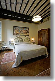 bedrooms, beds, europe, hotel albergo giglio, hotels, italy, montalcino, slow exposure, teracotta, towns, tuscany, vertical, photograph