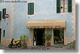 awnings, europe, general, horizontal, italy, montalcino, motorcycles, plants, stores, towns, tuscany, photograph