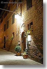 archways, bricks, doors, europe, italy, long exposure, montalcino, nite, plants, restaurants, stores, towns, tuscany, vertical, photograph