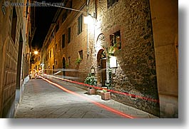 archways, bricks, doors, europe, horizontal, italy, light streaks, long exposure, montalcino, motion blur, nite, plants, restaurants, stores, towns, tuscany, photograph