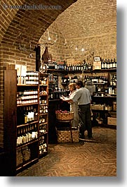 bottles, bricks, europe, italy, montalcino, stores, towns, tuscany, vertical, wines, photograph
