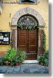 archways, bricks, doors, europe, italy, montalcino, plants, stores, towns, tuscany, vertical, wines, photograph