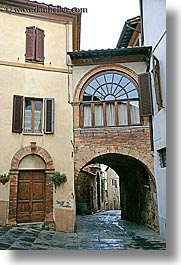 arches, archways, bricks, cobblestones, doors, europe, italy, montalcino, streets, towns, tuscany, vertical, windows, photograph