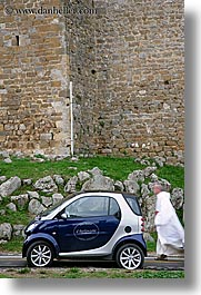 cars, europe, italy, monks, montalcino, people, streets, towns, tuscany, vertical, walking, photograph