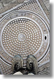 europe, feet, italy, manholes, montalcino, shoes, streets, towns, tuscany, vertical, photograph