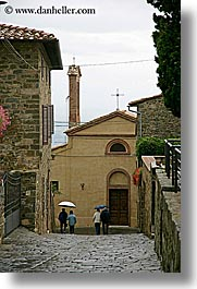 cobblestones, europe, italy, montalcino, people, streets, towns, tuscany, umbrellas, vertical, walking, photograph