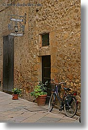 alleys, bicycles, europe, flowers, italy, pienza, plants, signs, towns, tuscany, vertical, photograph