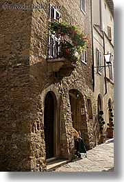 archways, balconies, europe, flowers, italy, pienza, plants, towns, tuscany, vertical, photograph