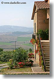 europe, flowers, houses, italy, pienza, plants, scenics, towns, tuscany, vertical, photograph