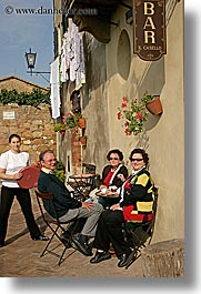 bars, cafes, europe, flowers, italy, local, people, pienza, plants, towns, tuscany, vertical, photograph