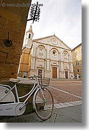 bell towers, bicycles, churches, europe, italy, pienza, religious, towns, tuscany, vertical, white, photograph
