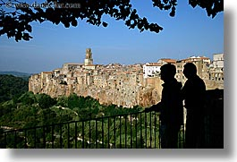 branches, cities, cityscapes, europe, horizontal, italy, leaves, men, old, pitigliano, silhouettes, towns, tuscany, photograph