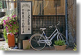 bicycles, europe, flowers, horizontal, italy, pitigliano, pizzeria, signs, towns, tuscany, photograph