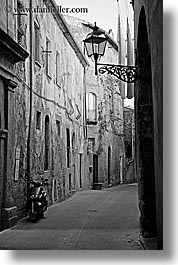 alleys, black and white, cobblestones, europe, italy, lamp posts, motorcycles, narrow streets, pitigliano, streets, towns, tuscany, vertical, photograph