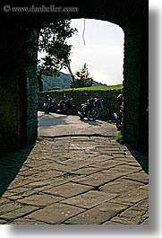 archways, europe, italy, motorcycles, populonia, towns, tuscany, vertical, photograph