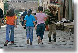 europe, girls, horizontal, italy, populonia, running, towns, tuscany, photograph