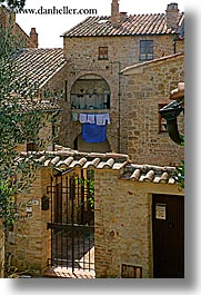 europe, hangings, italy, laundry, san quirico, stones, towns, tuscany, vertical, photograph