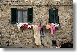 europe, hangings, horizontal, italy, laundry, san quirico, stones, towns, tuscany, photograph