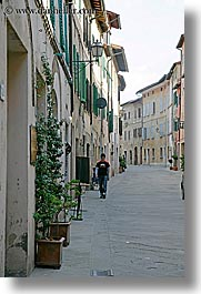 cobblestones, europe, italy, men, san quirico, towns, tuscany, vertical, walking, photograph