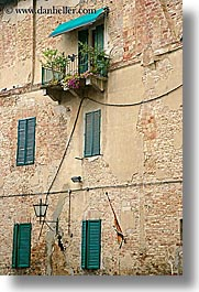 balconies, europe, italy, plants, siena, towns, tuscany, vertical, windows, photograph