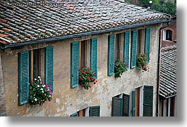 europe, flowers, geraniums, horizontal, italy, siena, towns, tuscany, windows, photograph