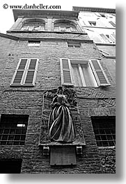 black and white, bricks, bronze, europe, italy, sculptures, siena, statues, towns, tuscany, vertical, walls, photograph