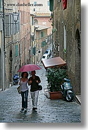 cobblestones, couples, europe, italy, people, siena, towns, tuscany, umbrellas, vertical, walking, photograph