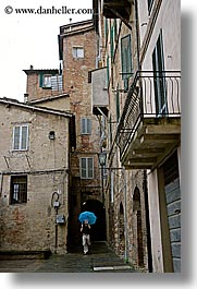cobblestones, europe, italy, men, people, photographers, siena, towns, tuscany, umbrellas, vertical, photograph