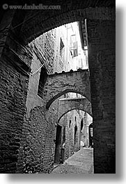 archways, black and white, bricks, cobblestones, europe, italy, narrow streets, siena, streets, towns, tuscany, vertical, photograph