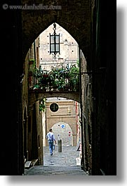 archways, cobblestones, europe, italy, men, narrow streets, siena, streets, towns, tuscany, vertical, walking, photograph