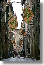 cobblestones, europe, flags, italy, narrow streets, people, siena, streets, towns, tuscany, vertical, walking, photograph