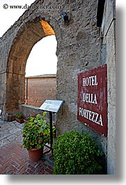 archways, europe, fortezza, fortress, hotels, italy, plants, signs, sorano, towns, tuscany, vertical, photograph