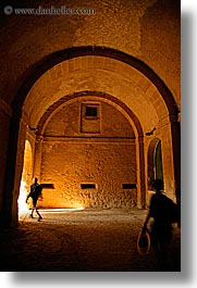 arches, archways, cobblestones, europe, fortress, italy, pedestrians, people, sorano, towns, tuscany, vertical, walking, photograph