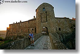 cobblestones, europe, fortress, horizontal, italy, people, sorano, sunsets, tourists, towns, tuscany, womens, photograph