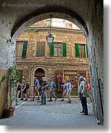 archways, europe, italy, people, sorano, tourists, towns, tuscany, under, vertical, walking, photograph