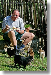 cats, dale, eating, europe, glasses, italy, men, people, steve, tourists, tuscany, vertical, photograph