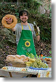 apron, bread, europe, foods, happy, italy, leaders, men, picnic, roberto, tourists, tuscany, twirling, vertical, photograph