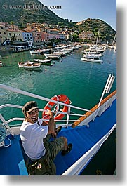 europe, happy, harbor, italy, leaders, men, pointing, tourists, tuscany, vertical, william, photograph