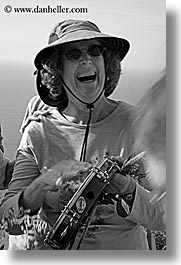 black and white, dorothy, europe, glasses, happy, hats, italy, malutta, playing, sunglasses, tamborine, tourists, tuscany, vertical, womens, photograph