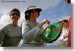 dorothy, europe, glasses, happy, hats, horizontal, italy, malutta, playing, sunglasses, tamborine, tourists, tuscany, womens, photograph