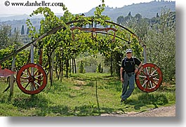 dave, europe, horizontal, italy, men, thornton, tourists, tuscany, wagon wheels, photograph