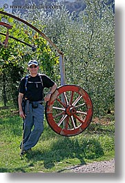 dave, europe, italy, men, thornton, tourists, tuscany, vertical, wagon wheels, photograph
