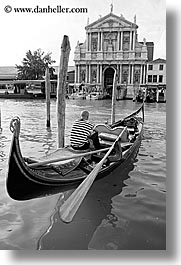 black and white, boats, buildings, canals, europe, gondolas, gondolier, italy, men, venecia, venezia, venice, vertical, photograph