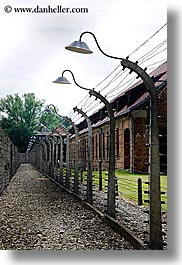 auschwitz, barbed, barbed wire, buildings, europe, fences, lights, poland, prison, prison camp, structures, vertical, wires, photograph