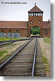 auschwitz, berkenau, bricks, buildings, europe, guard tower, materials, poland, prison, prison camp, railroad, structures, towers, tracks, vertical, photograph