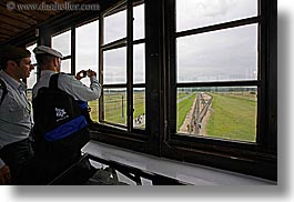 auschwitz, buildings, europe, from, guards, horizontal, men, military, poland, prison, prison camp, structures, towers, viewing, windows, photograph